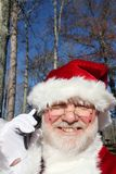 Santa Talking On His Cell Phone 2 Stock Photo