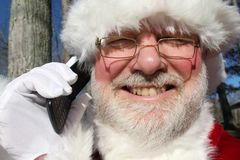 Santa Talking On His Cell Phone Royalty Free Stock Images