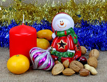 Santa tangerines and nuts. Stock Photos