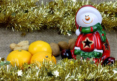Santa tangerines and nuts Royalty Free Stock Image