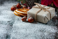 Santa Teddy Bear, Gift box wrapped linen cloth and decorated with  cord, christmas decoration on brown vintage wooden boards backg Stock Photography