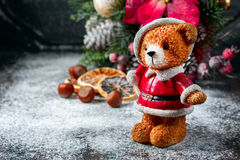 Santa Teddy Bear, Gift box wrapped linen cloth and decorated with  cord, christmas decoration on brown vintage wooden boards backg Royalty Free Stock Photo