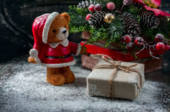 Santa Teddy Bear, Gift box wrapped linen cloth and decorated with  cord, christmas decoration on brown vintage wooden boards backg Royalty Free Stock Photos
