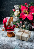 Santa Teddy Bear, Gift box wrapped linen cloth and decorated with  cord, christmas decoration on brown vintage wooden boards backg Stock Photos