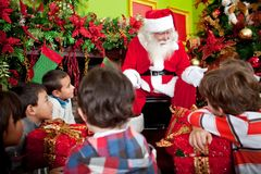 Santa telling a Christmas story Royalty Free Stock Photography