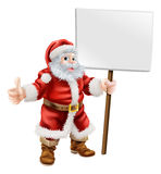 Santa tenant le signe et faisant des pouces  Photographie stock