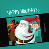 Santa, Thanksgiving turkey and elf take a holiday selfie Stock Images
