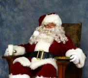 Santa tiene un bocado Foto de archivo