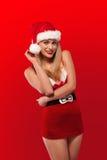 Santa tiene un pequeño ayudante atractivo Fotos de archivo libres de regalías