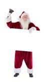 Santa tiene un segno e suona la sua campana Fotografie Stock Libere da Diritti