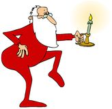 Santa tiptoeing with a candlestick Royalty Free Stock Photo