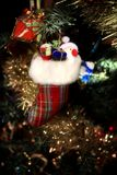 Santa in to a sock. Cute ornament for Christmas tree Stock Photography