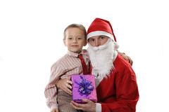 Santa together with the little boy. And a gift on a white background Royalty Free Stock Image