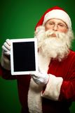 Santa with touchpad Royalty Free Stock Image