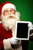 Santa with touchpad Stock Images