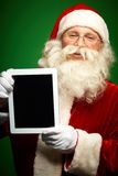 Santa with touchpad Royalty Free Stock Photo