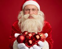 Santa with toy balls Royalty Free Stock Photography
