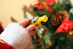 Santa with toy car Royalty Free Stock Images