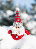 Santa toy in snowdrift Stock Image
