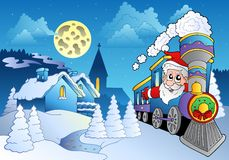 Santa on train near small village Stock Photo