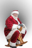 Santa tries out a new toy Royalty Free Stock Photography
