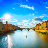 Santa Trinita Bridge on Arno river, sunset landscape. Florence,. Florence or Firenze, Ponte Santa Trinita medieval Bridge landmark on Arno river and a boat royalty free stock images