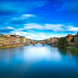 Santa Trinita and Old Bridge on Arno river, sunset landscape. Fl Stock Photo