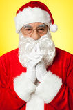 Santa trying to recollect his old memories Royalty Free Stock Photo