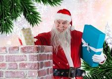 Santa umieszcza prezenty w komin Obraz Stock