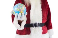Santa a un globe dans sa main Photos libres de droits