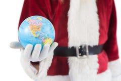 Santa a un globe dans sa main Photographie stock