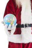 Santa a un globe dans sa main Photos stock