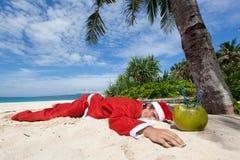 Santa under tropical palm Stock Image