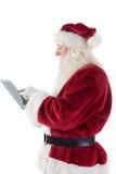 Santa uses a tablet PC Royalty Free Stock Image
