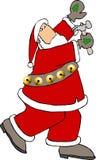 Santa using a hammer royalty free stock image