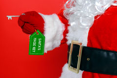 Santa using his magic key Royalty Free Stock Photography