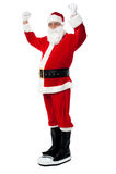 Santa utgjuter dyrbara pund! Royaltyfria Bilder