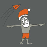 Santa on vacation. Looking at paper airplane Royalty Free Illustration