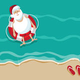 Santa on vacation in an inner tube Stock Photo