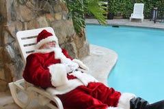 Santa Vacationing durmiente Foto de archivo
