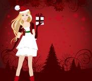 Santa vestiu a menina com presente. Fotografia de Stock