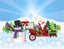 Santa on Vintage Car With Snow Scene Stock Image