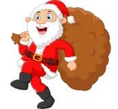Santa walking and holding sack Royalty Free Stock Images