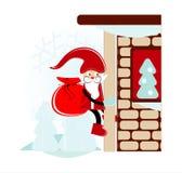 Santa on wall. Santa with gift on wall Royalty Free Stock Image
