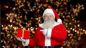 Santa is wanting you to be interersted in the gift. stock video footage
