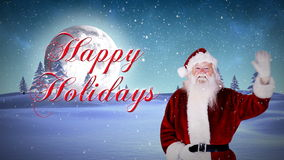 Santa waving at camera with happy holidays message stock video footage