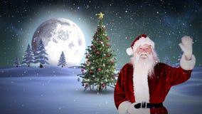 Santa waving at camera in snowy landscape