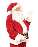 Santa Waving. Santa Claus waving his hand on a white background Stock Photos