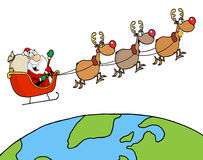 Santa waving and flying above earth Royalty Free Stock Image