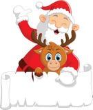 Santa waving and holding blank sign Stock Photo